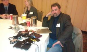 Turbo was caught unawares at the TechTarget Online ROI Summit in downtown Austin yesterday. Among the devices identified there on the table: A Verizon Mi-Fi hotspot, Turbo's Verizon LG feature phone, a 5th gen iPod Touch, a